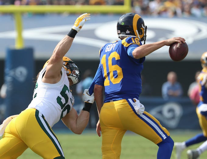 Green Bay Packers linebacker Clay Matthews (52) closes in on quarterback Jared Goff (16) against the LA Rams Sunday, October 28, 2018 at the Memorial Coliseum in Los Angeles.
