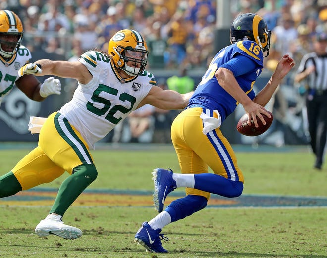 Green Bay Packers linebacker Clay Matthews (52) pursues quarterback Jared Goff (16) against the LA Rams Sunday, October 28, 2018 at the Memorial Coliseum in Los Angeles.