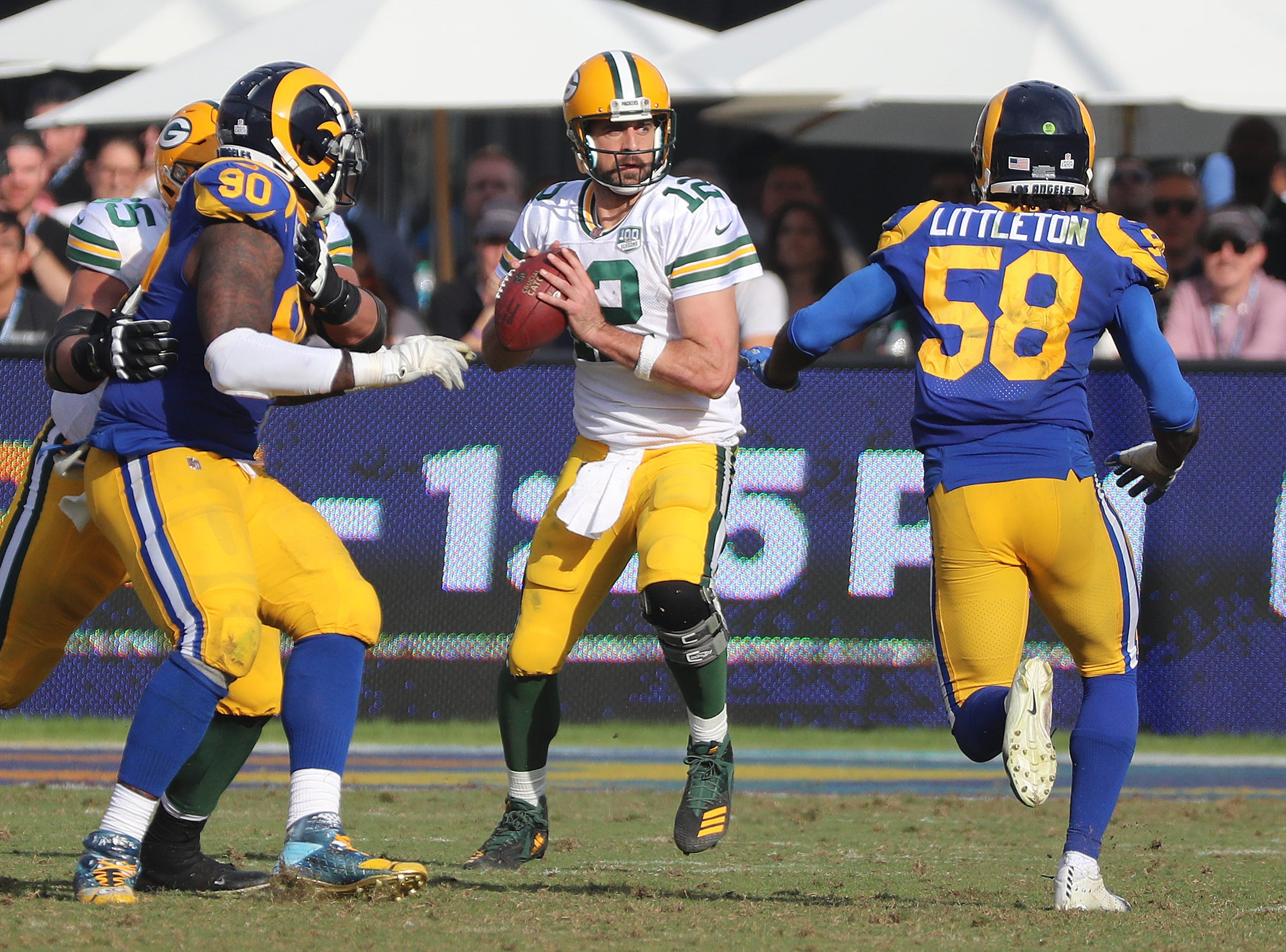Green Bay Packers quarterback Aaron Rodgers (12) throws under pressure against the LA Rams Sunday, October 28, 2018 at the Memorial Coliseum in Los Angeles.