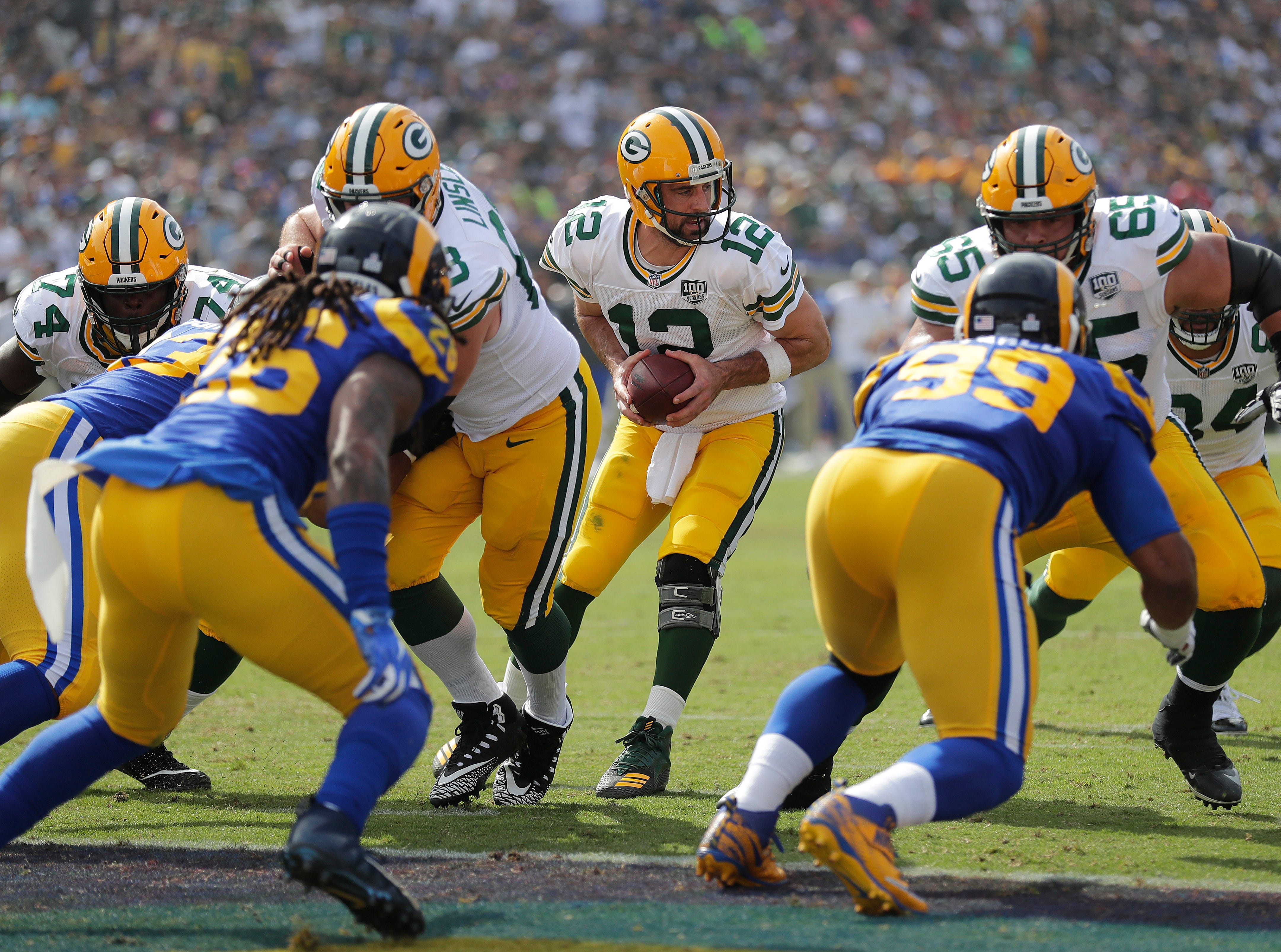 Green Bay Packers quarterback Aaron Rodgers (12) takes the snap at the goal line against the LA Rams Sunday, October 28, 2018 at the Memorial Coliseum in Los Angeles.