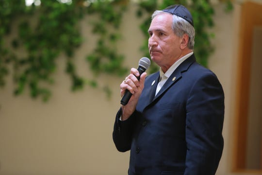 State Senator Jeff Stone speaks at Temple Isaiah in Palm Springs, Calif., during a vigil to honor victims of the shooting at the Tree of Life Synagogue, Sunday, October 28, 2018.