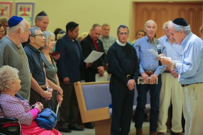 After a series of brief speeches community members say the Kaddish at Temple Isaiah in Palm Springs, Calif., to honor the victims of the Tree of Life Synagogue shooting, October 28, 2018.