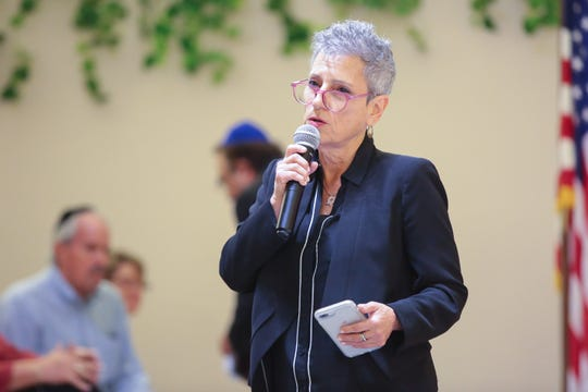 State Senate candidate Joy Silver speaks at Temple Isaiah in Palm Springs, Calif., during a vigil to honor victims of the shooting at the Tree of Life Synagogue, Sunday, October 28, 2018.