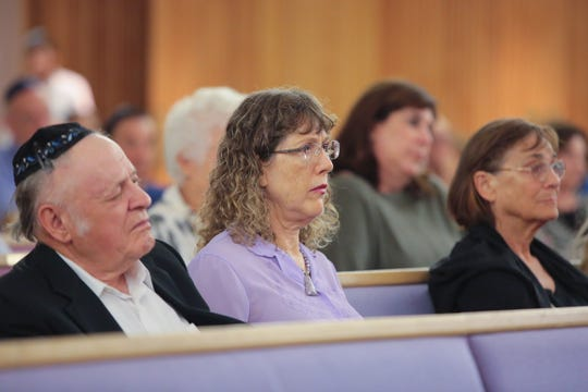 Community members gather at Temple Isaiah in Palm Springs, Calif., to honor victims of the shooting at the Tree of Life Synagogue in Pittsburgh, Sunday, October 28, 2018.