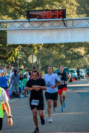 A runner checks his time at the finish line of a previous Great Pumpkin Run.