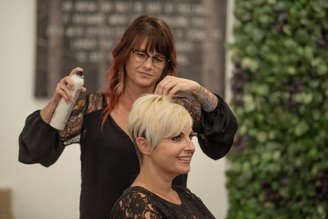 Christa Bartok finishes Toni Odom's  hair at Arrow Salon.