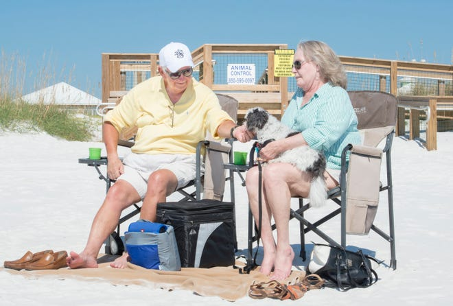 Bruce and Patricia Mackey, of Molino, spend some time with their dog Gabby at the dog beach in Pensacola on Monday, October 29, 2018.