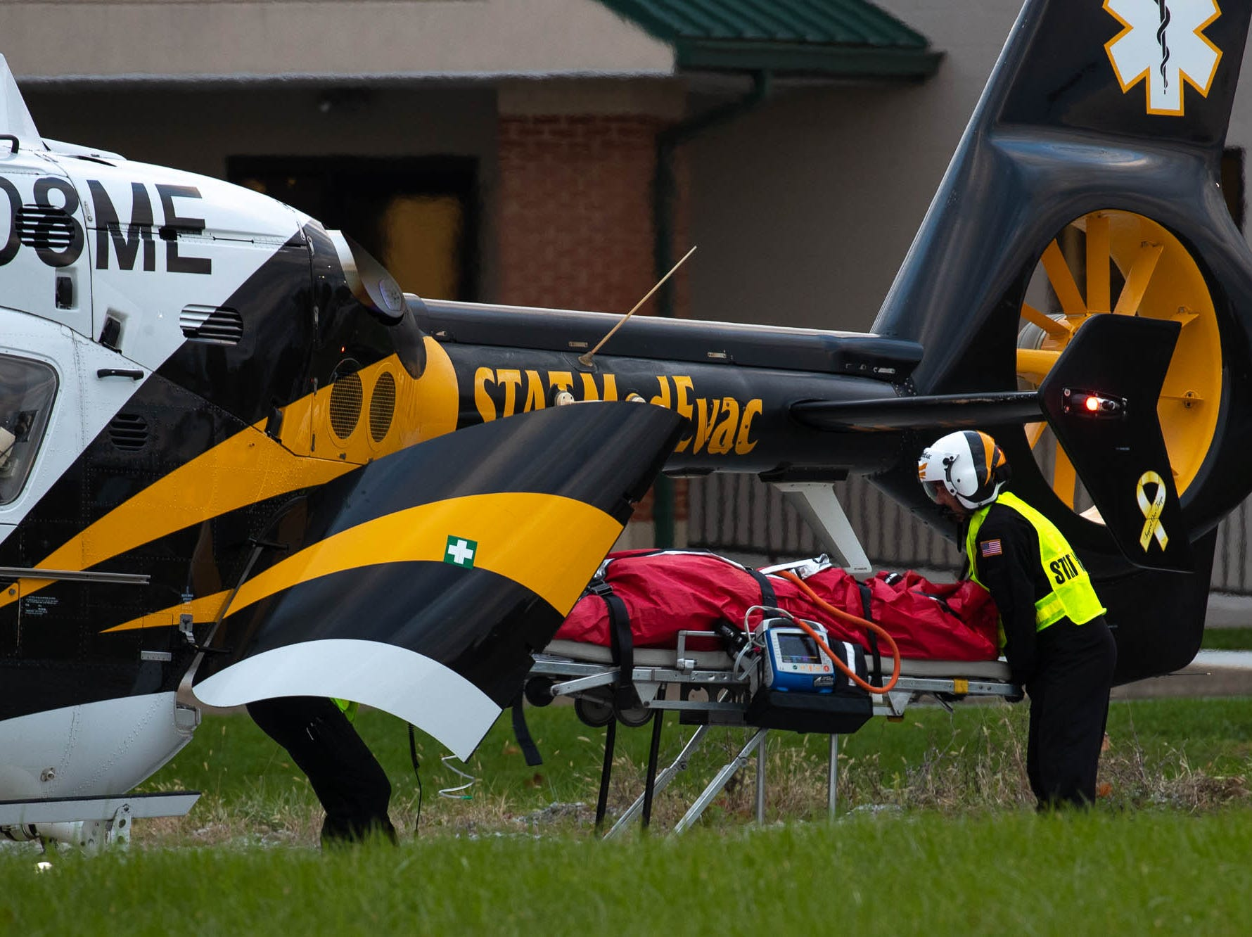 Medical personnel transport a 69-year-old man to a medical helicopter on the 500 block of West King St. after a domestic-related stabbing on the 300 block of Lexington Way, Monday, Oct. 29, 2018, in Littlestown. Littlestown Police Chief Charles Keller said that a 70-year-old woman stabbed a 69-year-old man, and the man was flown to York Hospital.
