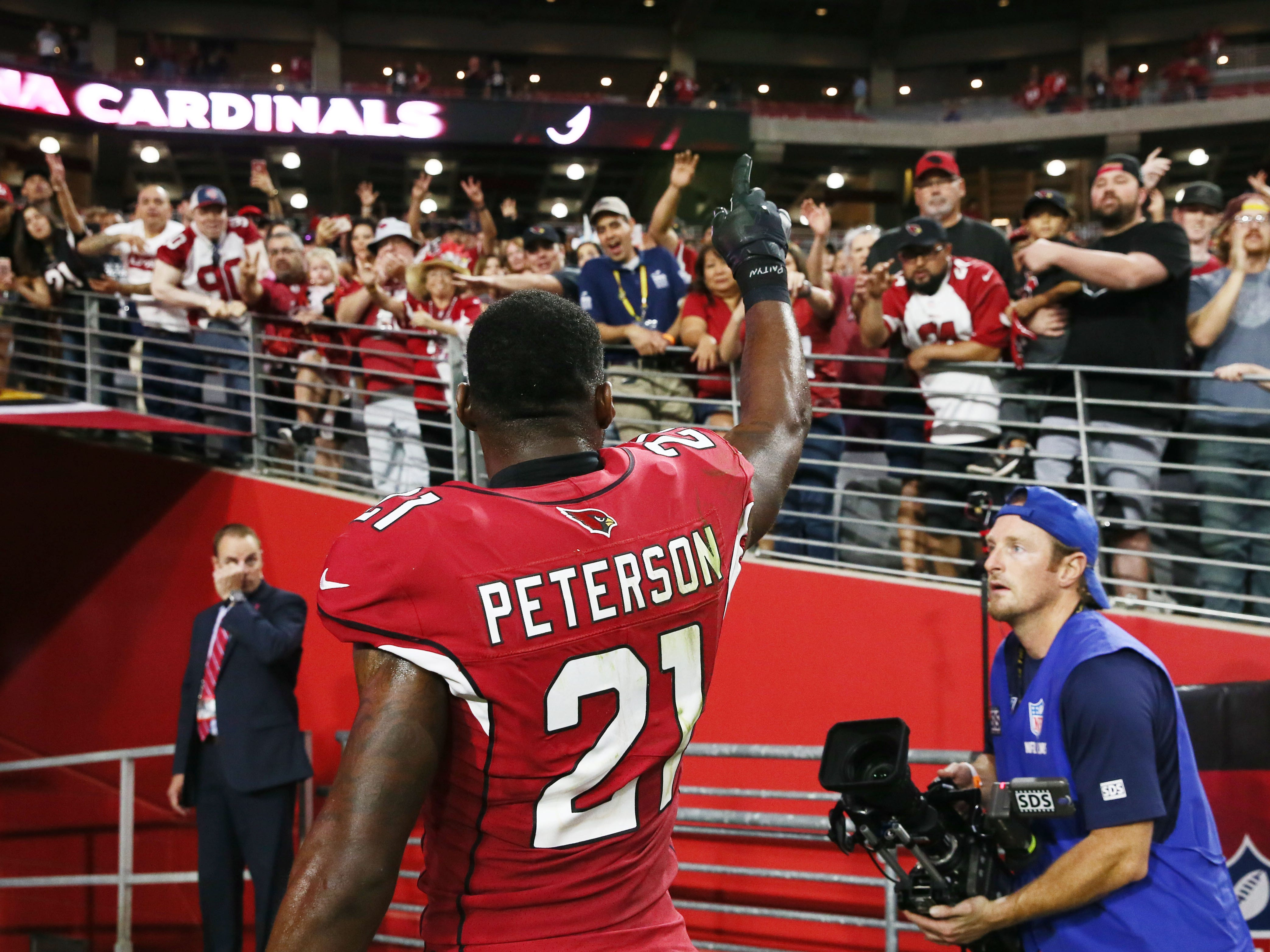 Arizona Cardinals fans cheer for Patrick Peterson after defeating the San Francisco 49ers 18-15 during a game on Oct. 28 at State Farm Stadium.