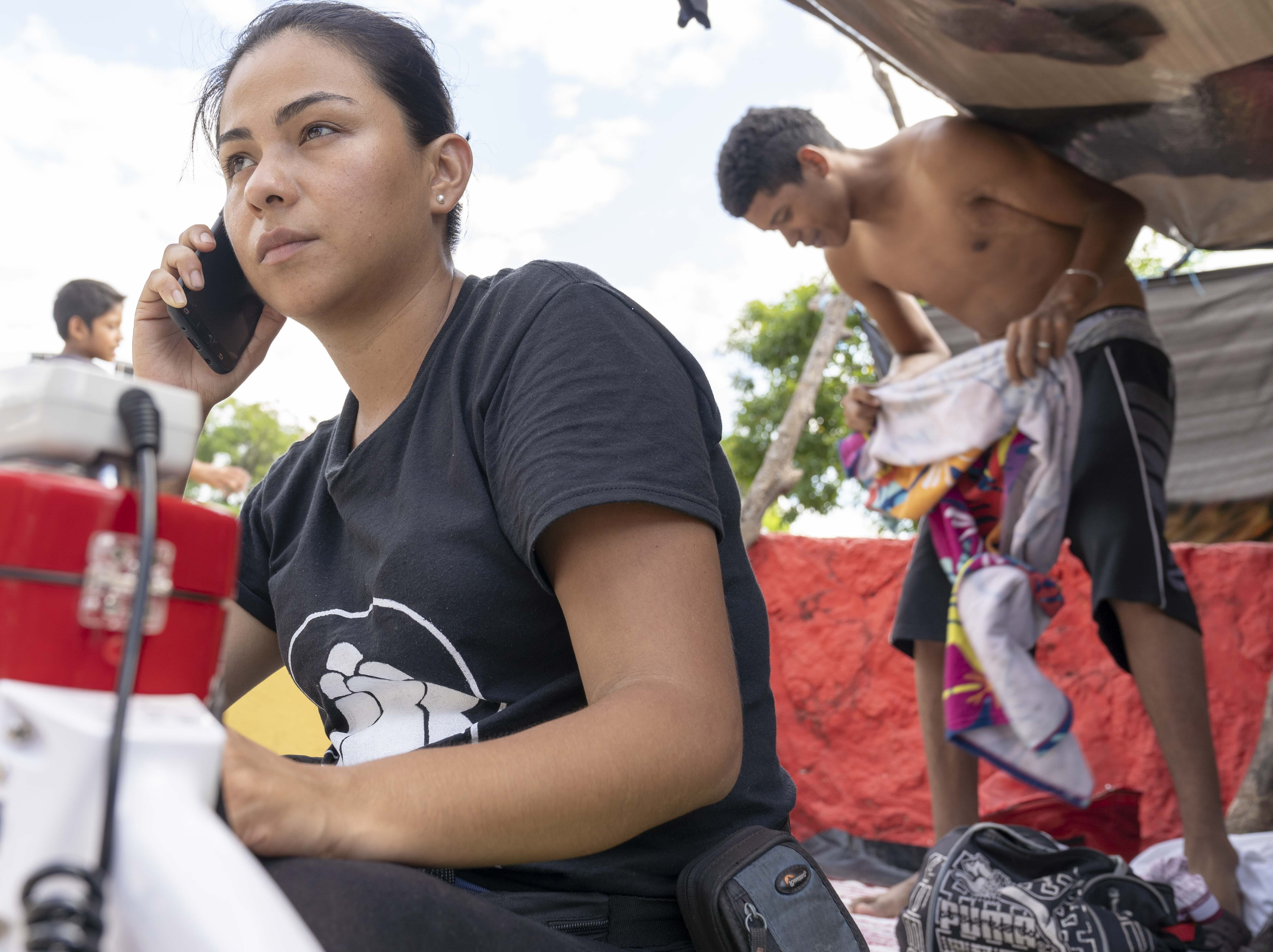 Gina Garibo, one of the organizer of the Migrant Caravan working on details for tomorow's journey. The thousands of migrants from Honduras and other Central American countries traveling in a huge caravan toward the U.S. took a day off to rest on Sunday, Oct. 28, 2018.