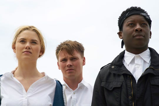 "In ""Monster Party,"" Iris (Virginia  Gardner), Casper (Sam Strike, center) and Dodge (Brandon Micheal Hall) are thieves who target affluent households."