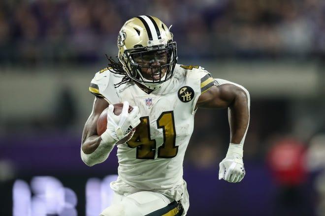 New Orleans Saints running back Alvin Kamara (41) carries the ball during the fourth quarter against the Minnesota Vikings at U.S. Bank Stadium.