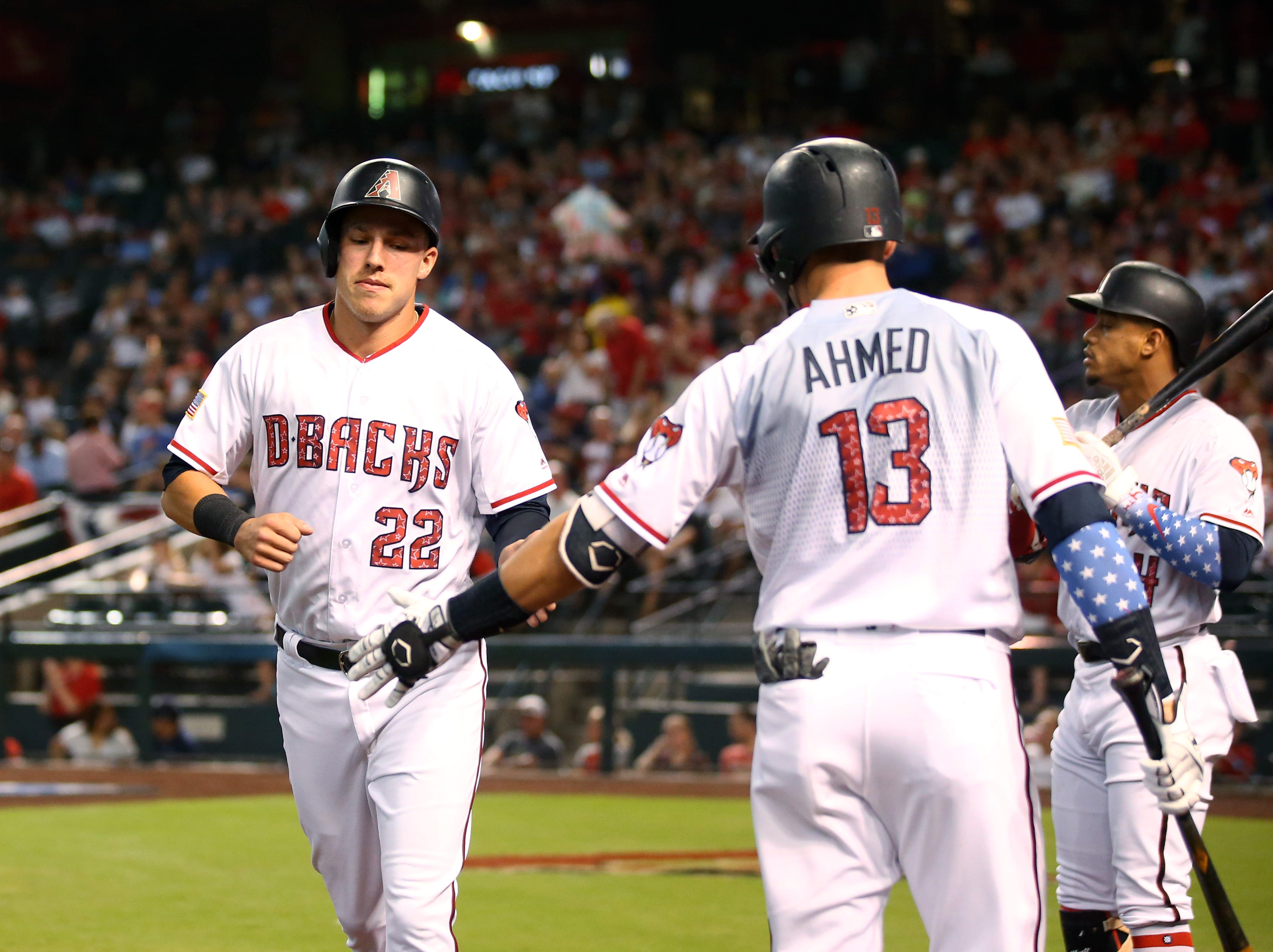 "Arizona Diamondbacks third baseman Jake Lamb (left) celebrates with teammate Nick Ahmed after scoring a run in a game against the St. Louis Cardinals at Chase Field this past season. Lamb paid $2.795 million for a ""modern farmhouse"" in Scottsdale's Arcadia neighborhood, real estate records show."
