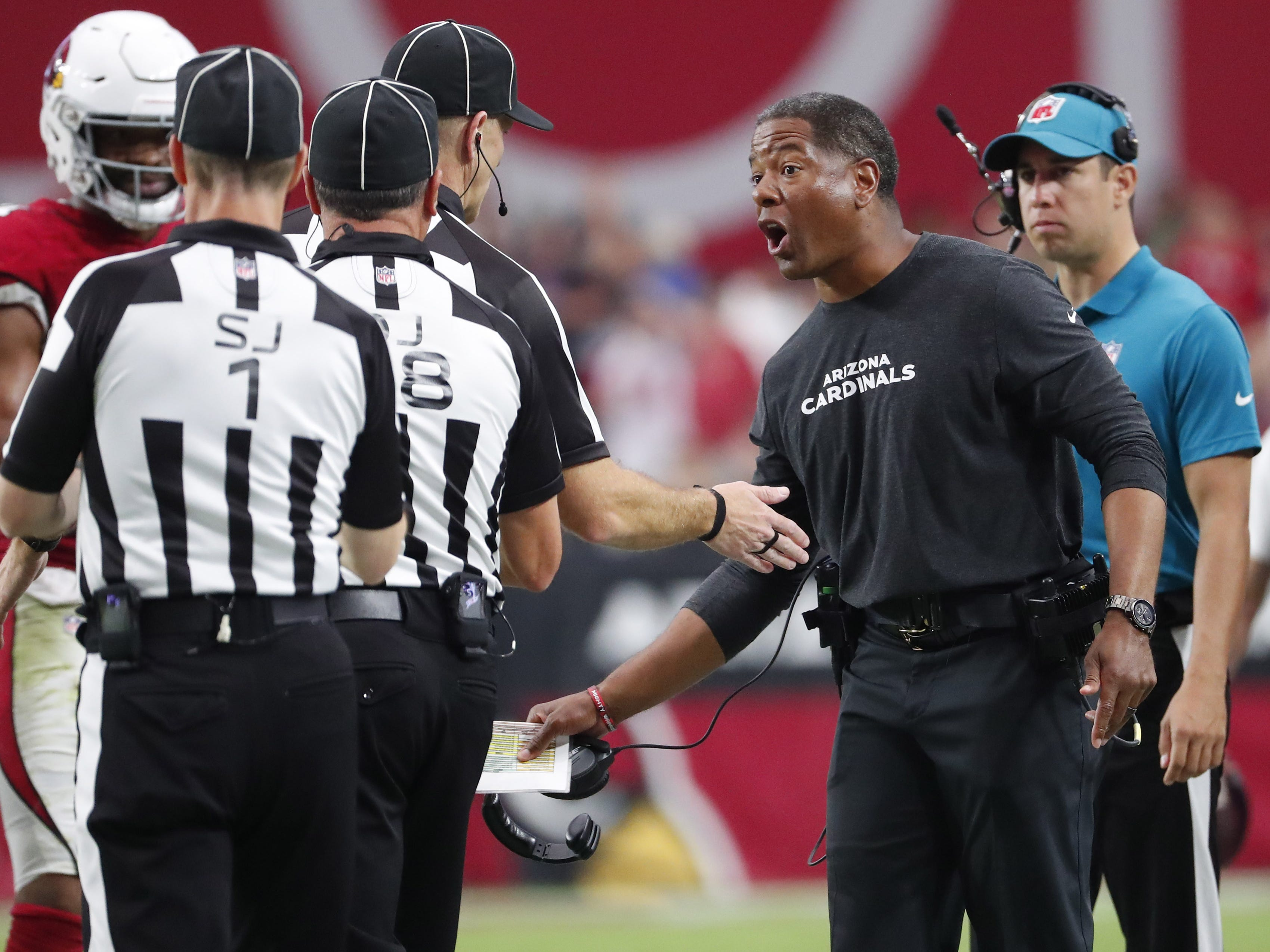 Arizona Cardinals head coach Steve Wilks argues a fumble with officials in the fourth quarter during NFL action against the San Francisco 49ers on Oct. 28 at State Farm Stadium.
