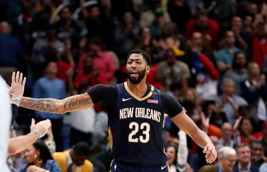 New Orleans Pelicans forward Anthony Davis (23) celebrates after they defeated the Brooklyn Nets by two points in an NBA basketball game in New Orleans, Friday, Oct. 26, 2018. The Pelicans won 117-115. (AP Photo/Gerald Herbert)