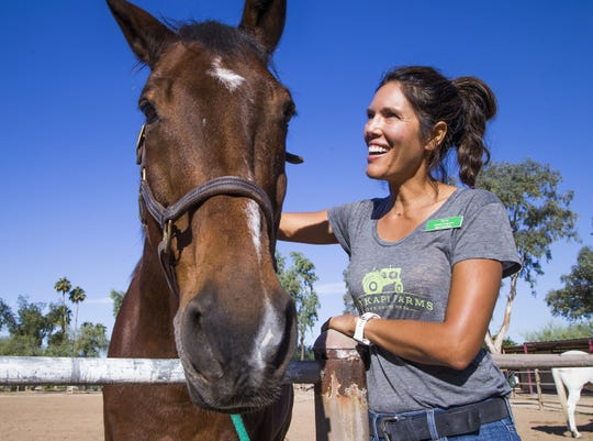 Terra Schadd, founder of Hunkapi Farms in Scottsdale,  runs a program that allows students with autism tp interact with horses at the farm.
