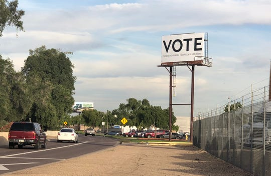 Billboards paid for by the nonpartisan nonprofit Vote.org have sprouted up all over Phoenix.