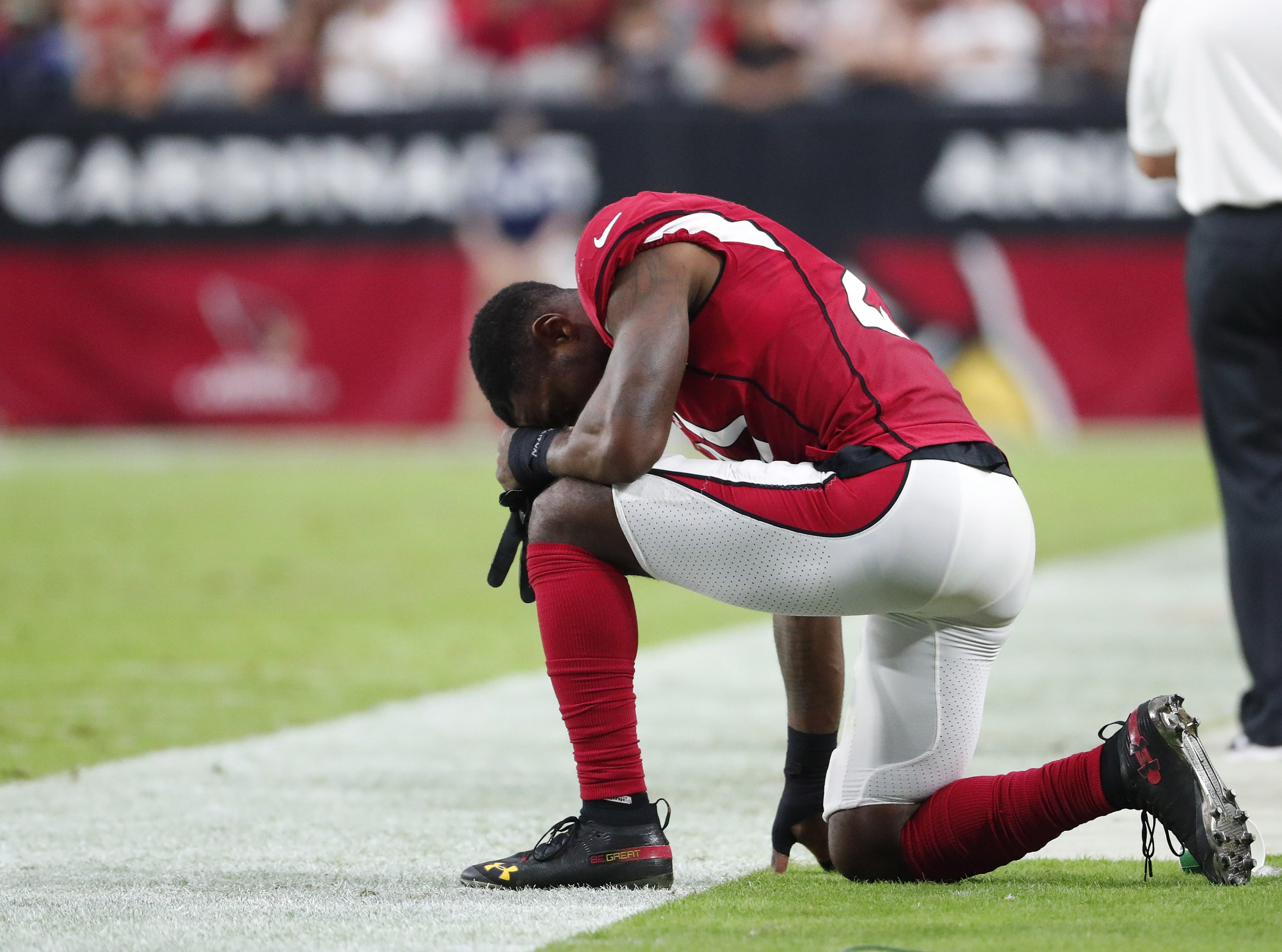 Arizona Cardinals cornerback Patrick Peterson (21) kneels on the sidelines in the fourth quarter during NFL action against the San Francisco 49ers on Oct. 28 at State Farm Stadium.