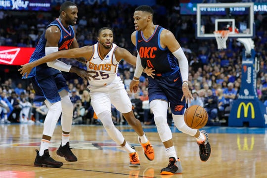 Oct 28, 2018; Oklahoma City, OK, USA; Oklahoma City Thunder guard Russell Westbrook (0) drives to the basket as Phoenix Suns forward Mikal Bridges (25) defends during the second half at Chesapeake Energy Arena. Oklahoma City won 117-110. Mandatory Credit: Alonzo Adams-USA TODAY Sports