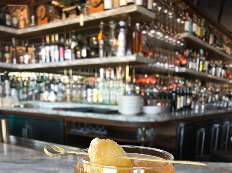 The Devil's Pear cocktail at Fat Ox features pear liqueur and ginger  bitters.