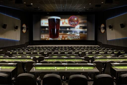 Flix Brewhouse features stadium-style seating with Easy Glider chairs and tables.