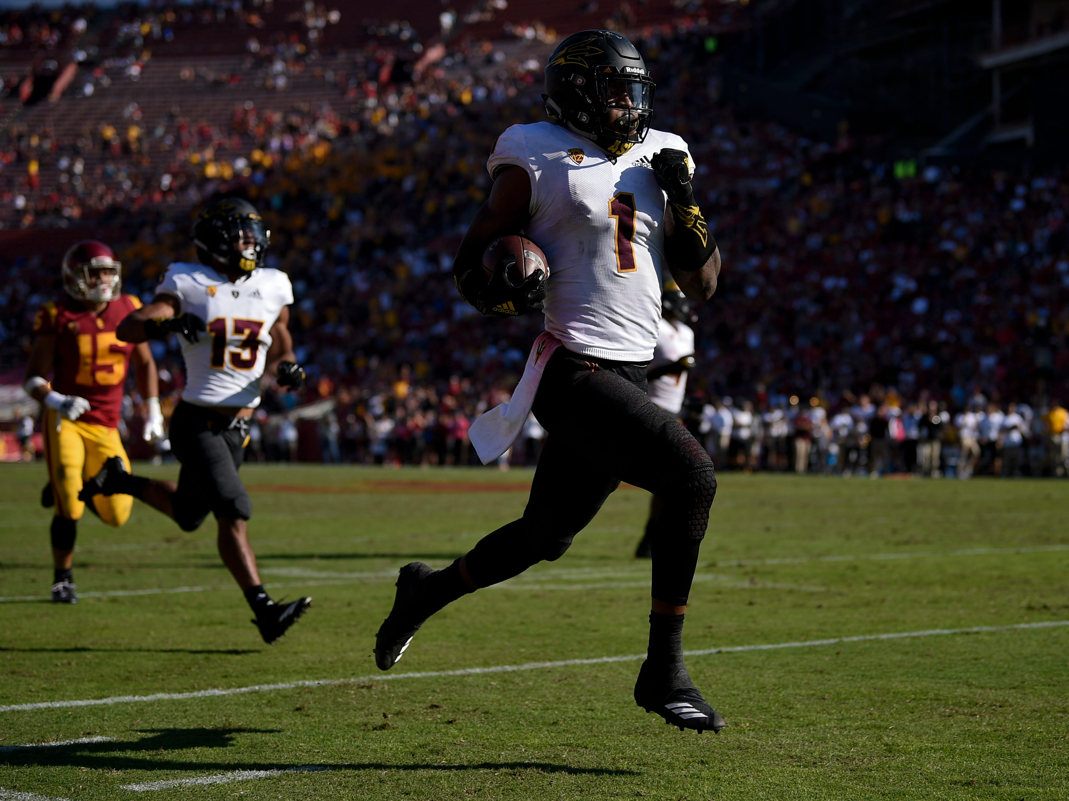 Arizona State Sun Devils wide receiver N'Keal Harry (1) runs a punt return for a touchdown during the second half against the Southern California Trojans at Los Angeles Memorial Coliseum.