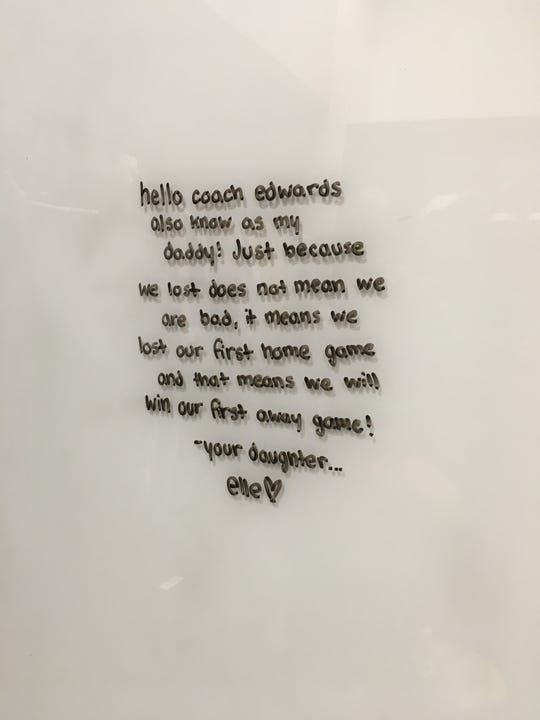 A note from Herm Edwards' daughter is still on the whiteboard in his office.