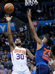 Oct 28, 2018; Oklahoma City, OK, USA; Phoenix Suns guard Troy Daniels (30) against Oklahoma City Thunder guard Terrance Ferguson (23) during the second quarter at Chesapeake Energy Arena. Mandatory Credit: Alonzo Adams-USA TODAY Sports