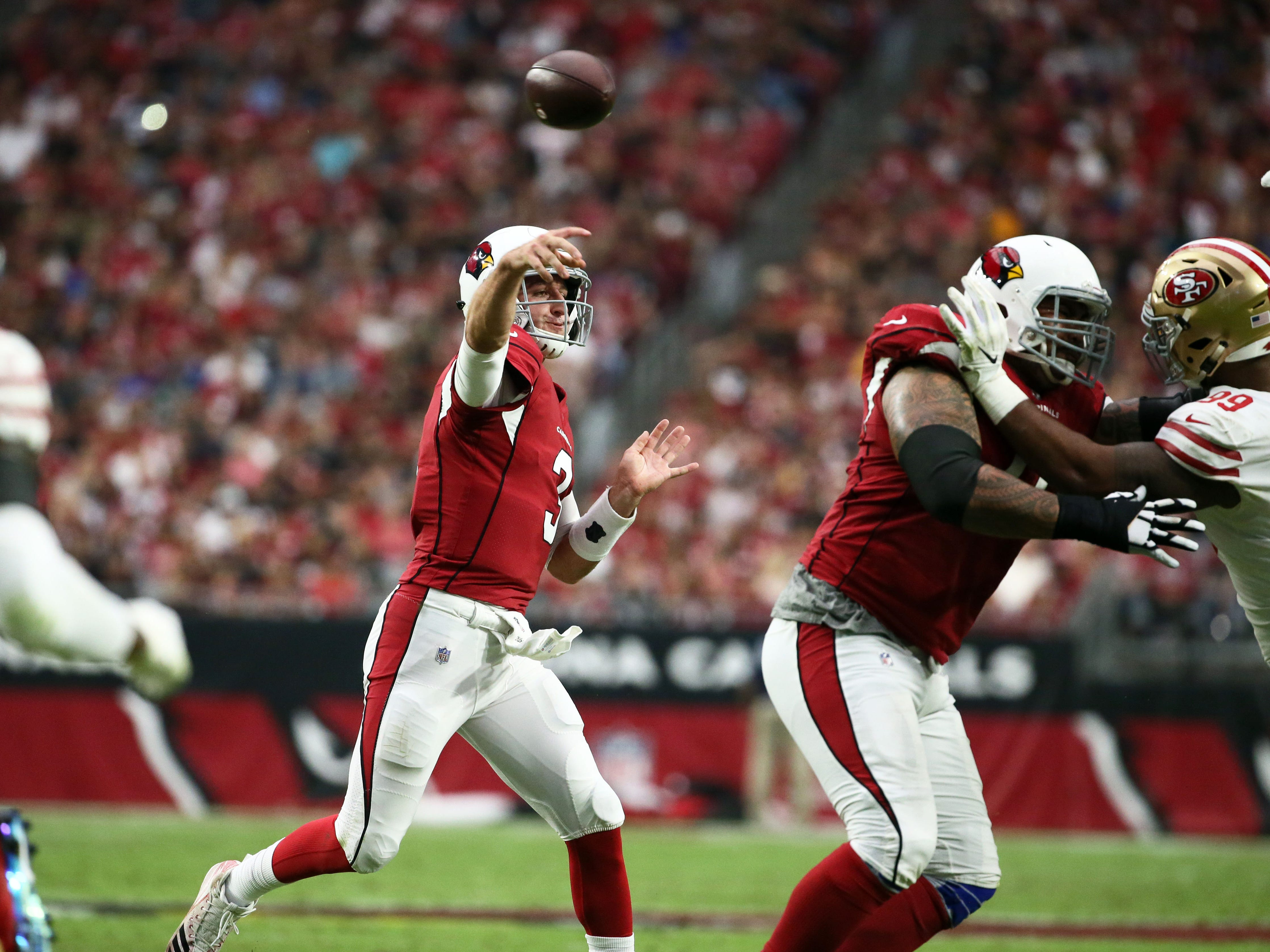 Arizona Cardinals quarterback Josh Rosen throws a pass against the San Francisco 49ers in the first half during a game on Oct. 28 at State Farm Stadium.
