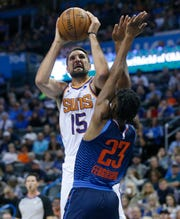 Phoenix Suns forward Ryan Anderson (15) shoots as Oklahoma City Thunder guard Terrance Ferguson (23) defends in the first half of an NBA basketball game in Oklahoma City, Sunday, Oct. 28, 2018. (AP Photo/Sue Ogrocki)