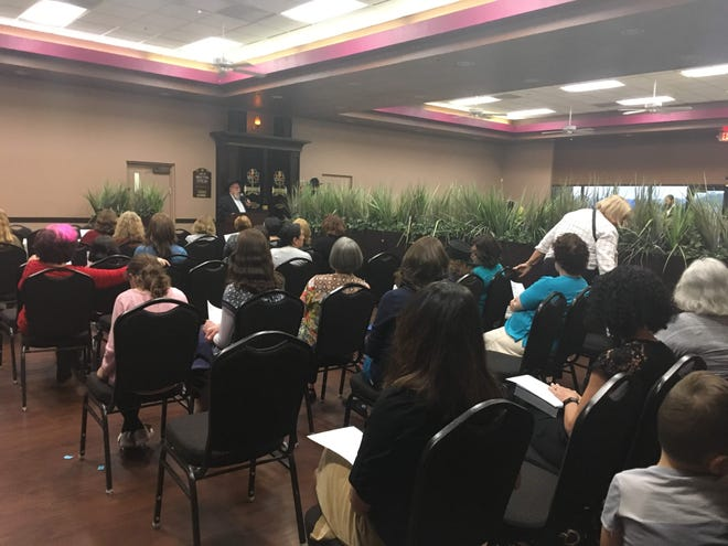 Rabbi Zalman Levertov speak to a crowd of about 50 Jewish people gathered at Chabad Lubavitch in Phoenix, urging them to love freely and be compassionate in the face of tragedy.