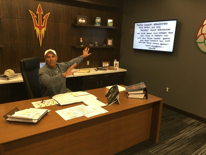 Herm Edwards shows off a note from his daughter predicting ASU's victory over USC on the road.