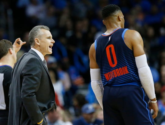 Oklahoma City Thunder head coach Billy Donovan talks to guard Russell Westbrook (0) inthe first half of an NBA basketball game against the Phoenix Suns in Oklahoma City, Sunday, Oct. 28, 2018. (AP Photo/Sue Ogrocki)