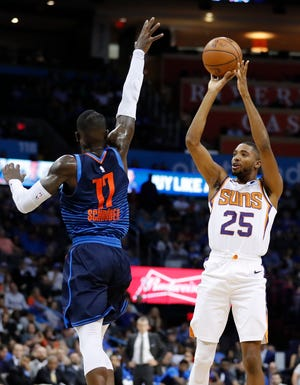 Oct 28, 2018; Oklahoma City, OK, USA; Phoenix Suns forward Mikal Bridges (25) shoots as Oklahoma City Thunder guard Dennis Schroder (17) defends during the second quarter at Chesapeake Energy Arena. Mandatory Credit: Alonzo Adams-USA TODAY Sports