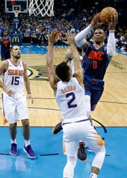 Thunder guard Russell Westbrook shoots over Suns guard Elie Okobo during the first half of a game on Oct. 28.
