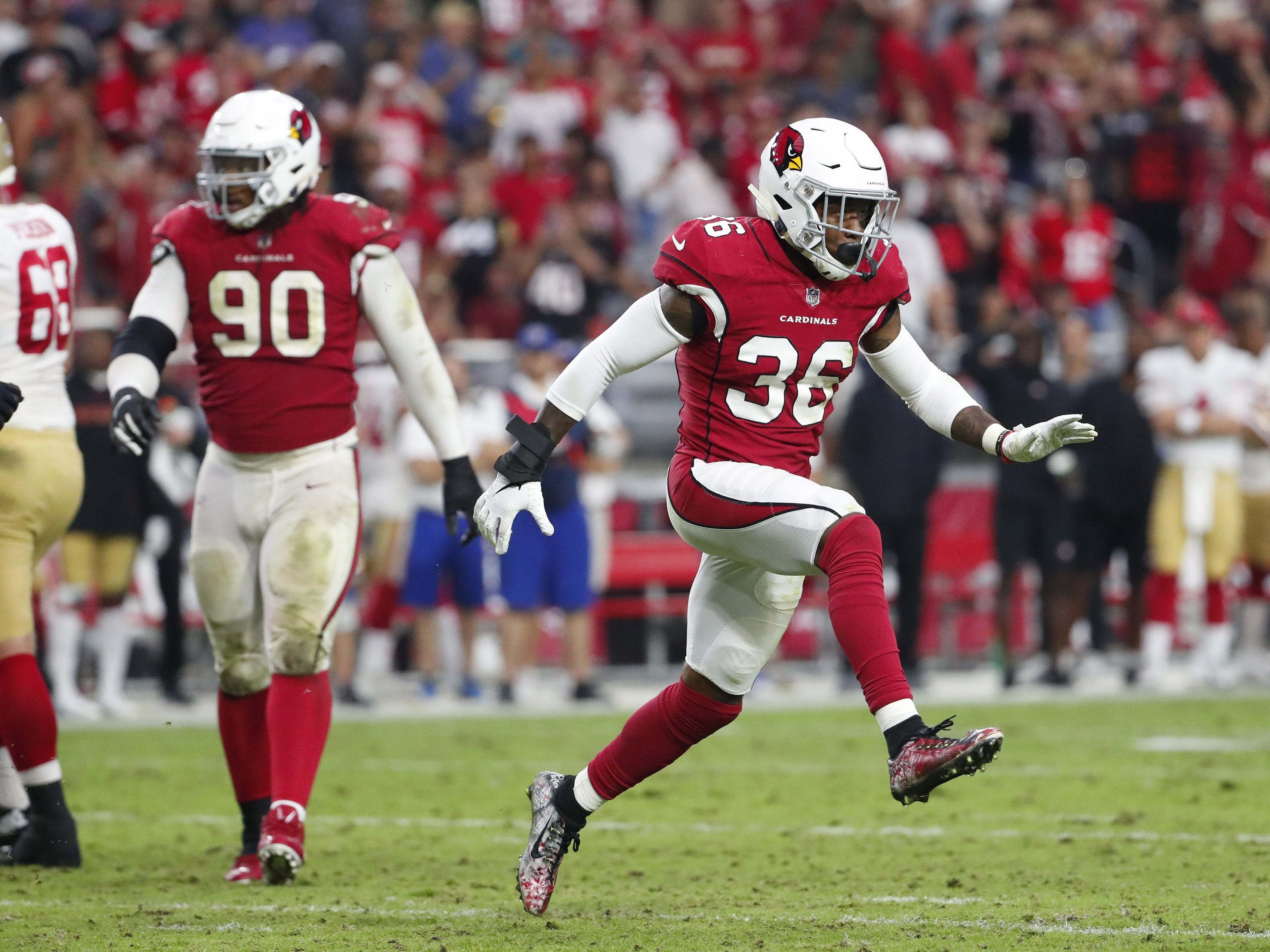 Arizona Cardinals strong safety Budda Baker (36) reacts after a sack In the fourth quarter during NFL action against the San Francisco 49ers on Oct. 28 at State Farm Stadium.