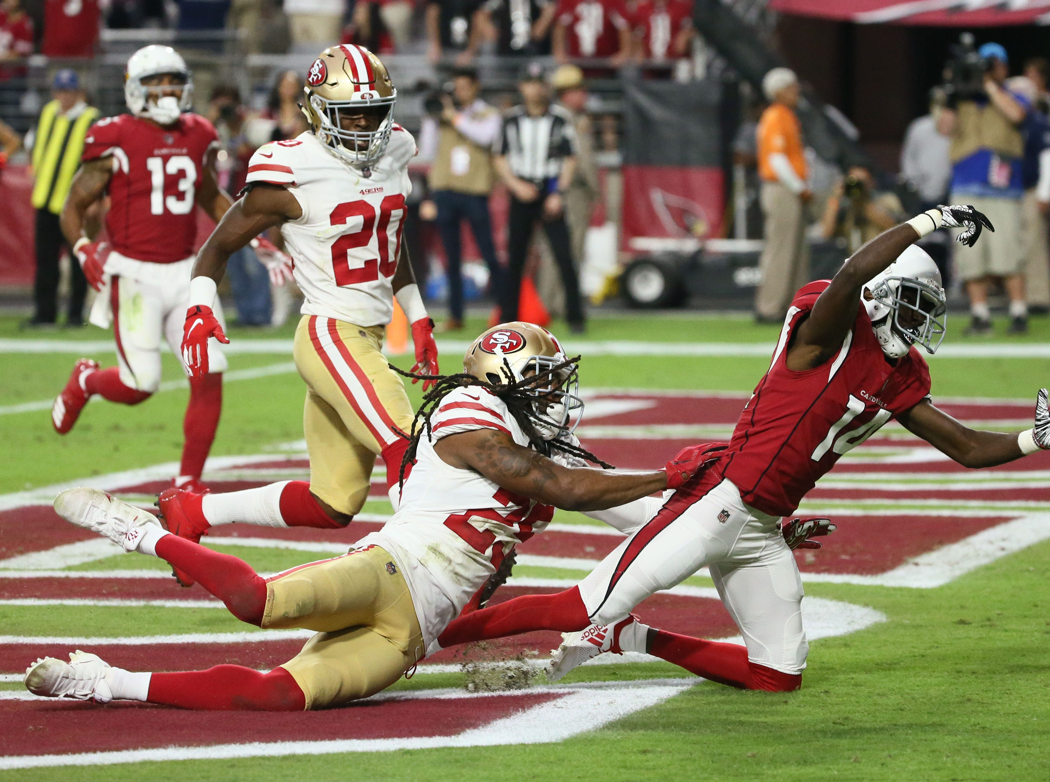 Arizona Cardinals wide receiver J.J. Nelson misses a touchdown catch against the San Francisco 49ers in the second half during a game on Oct. 28 at State Farm Stadium.