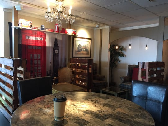 Part of the spacious seating area inside The Queens Coffee House with decor that will remind you of England.