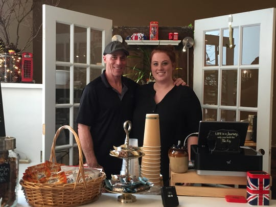 Paul Neumann (left) and his daughter, Casey, owners of Tip Top Consignment Shoppe and The Queens Coffee House.