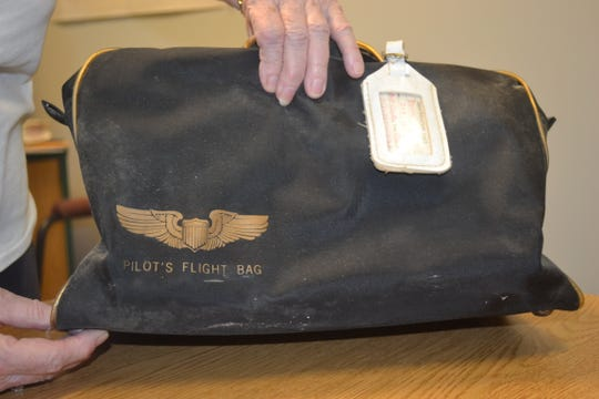 Edna Hansen's pilot bag is a little dusty. It's been in storage since she made her last flight around 1999.