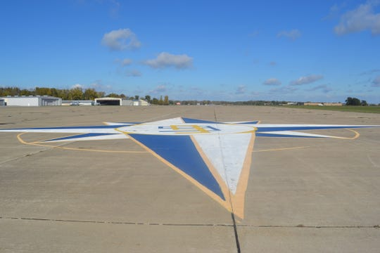 The All-Ohio 99s chapter of the Ninety-Nines painted this Compass Rose at the Erie-Ottawa International Airport about eight years ago. The compass points pilots to true north.