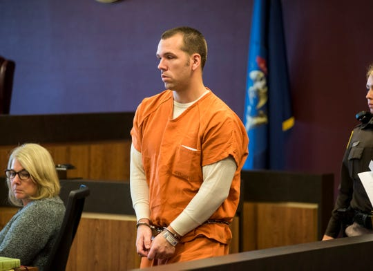 Joshua Bauman enters Judge Daniel Kelly's courtroom before his pre-trial hearing Oct. 29, 2018. Bauman is being charged in the fatal Aug. 24 shooting of Port Huron Police Lt. Joel Wood and the wounding of two other people. His lawyer has filed a motion to have Bauman undergo examination for criminal responsibility at the Center for Forensic Psychiatry in Saline.