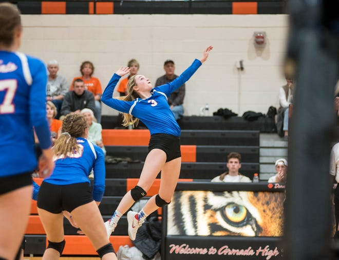 St. Clair High School's Mia Janssen (3) jumps to hit the ball during their division 2 girls volleyball game against Armada High School Monday, Oct. 29, 2018 at Armada High School.