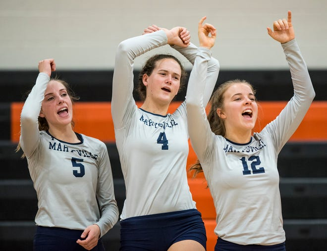 Players from Marysville High School cheer after a point during their Division 2 girls volleyball game against Algonac High School Monday, Oct. 29, 2018 at Armada High School.