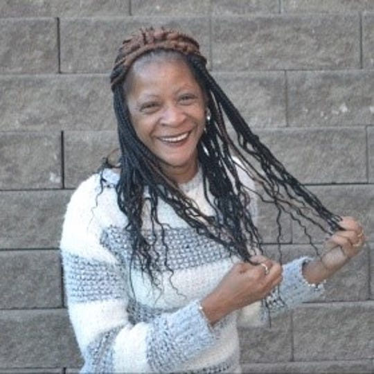 DeeDee Wheeler smiles in a posed photo. A former crack cocaine addiction, she went through a year-long treatment program at the Hoving Home and began working at Unshattered in 2016.