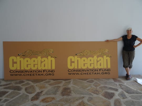 Paola Bari is shown in Africa with the logo she painted for the Cheetah Conservation Fund.
