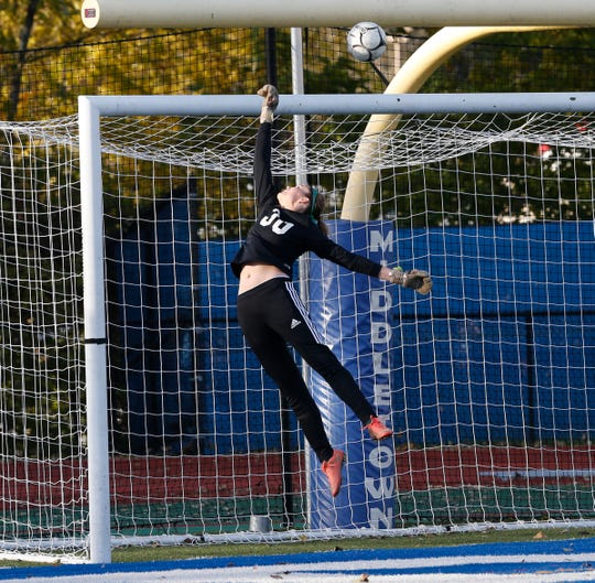Spackenkill's Madison McCall leaps for the ball during an Oct. 29 Section 9 Class B girls soccer final against James I. O'Neill in Middletown.