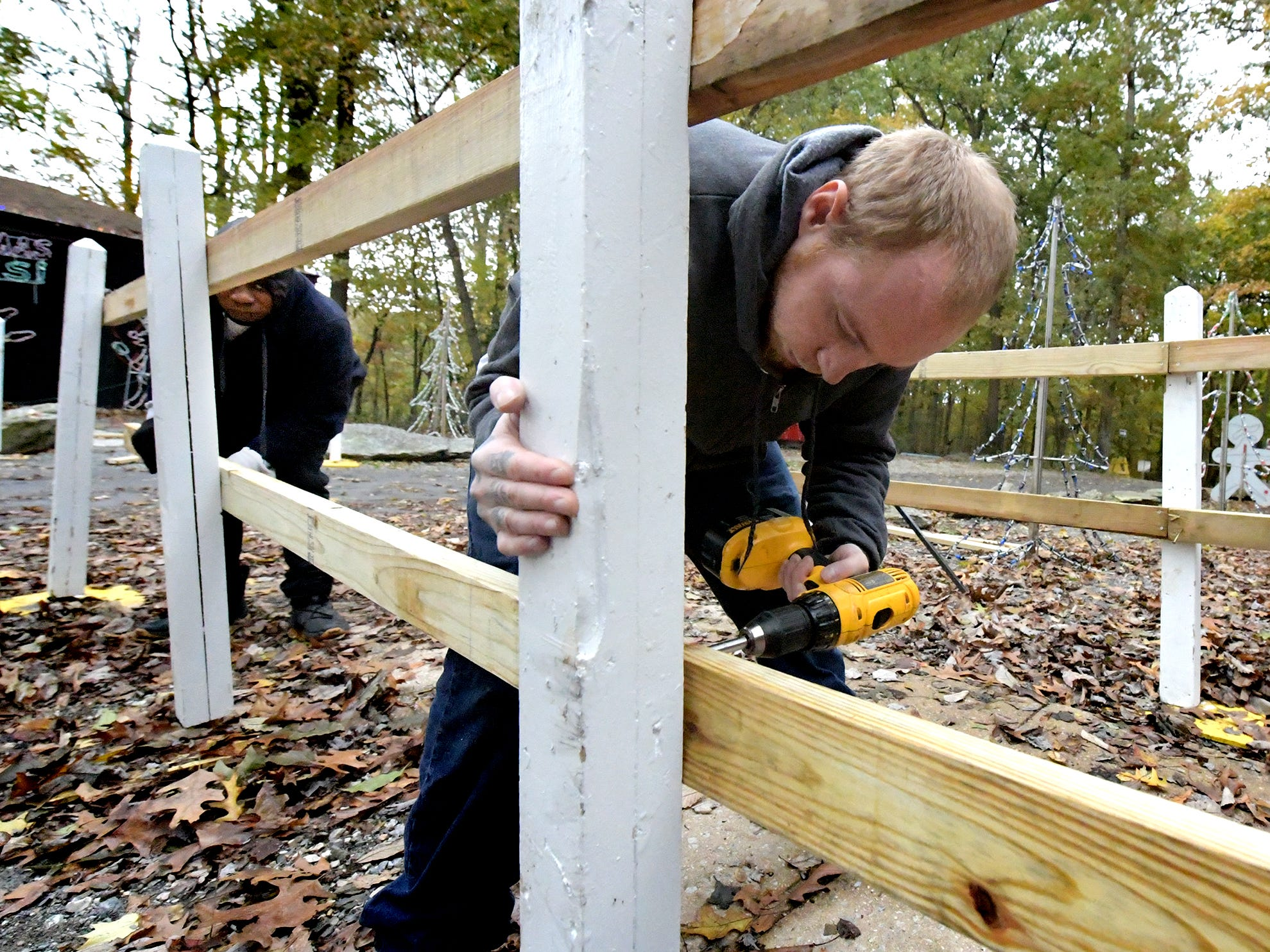 York County work release inmates Cody Miller and Paul Hinton, left, construct a fence at Rocky Ridge Park, Monday, Oct. 29, 2018, while preparing for the Christmas Magic event. The event, featuring 600,000 lights along a half-mile trail, is in its 35th year. Christmas Magic runs daily from Nov. 23 through December 31. It is closed on Dec. 24 and 25. Hours for the event are Monday through Thursday, 6-9 p.m.; and Friday through Sunday, 5-9 p.m. Tickets will available online starting in early November, according to the department's website. Friday, Saturday and Sunday require pre-purchased ticket sales. Bill Kalina photo