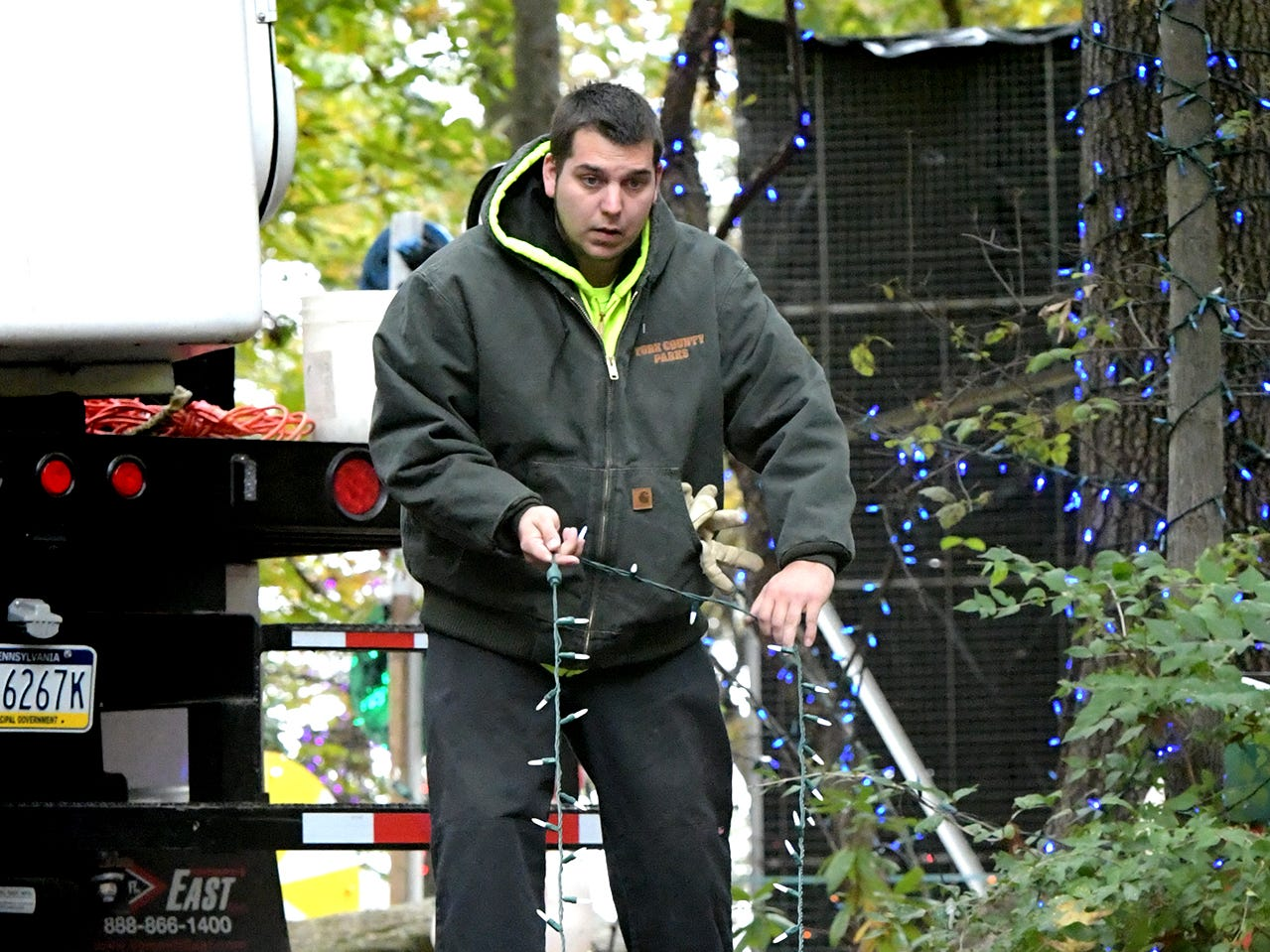 York County Parks and Recreation employee Mike Leiphart extends a string of lights from a spool at Rocky Ridge Park, Monday, Oct. 29, 2018, while preparing for the Christmas Magic event. The event, featuring 600,000 lights along a half-mile trail, is in its 35th year. Christmas Magic runs daily from Nov. 23 through December 31. It is closed on Dec. 24 and 25. Hours for the event are Monday through Thursday, 6-9 p.m.; and Friday through Sunday, 5-9 p.m. Tickets will available online starting in early November, according to the department's website. Friday, Saturday and Sunday require pre-purchased ticket sales. Bill Kalina photo