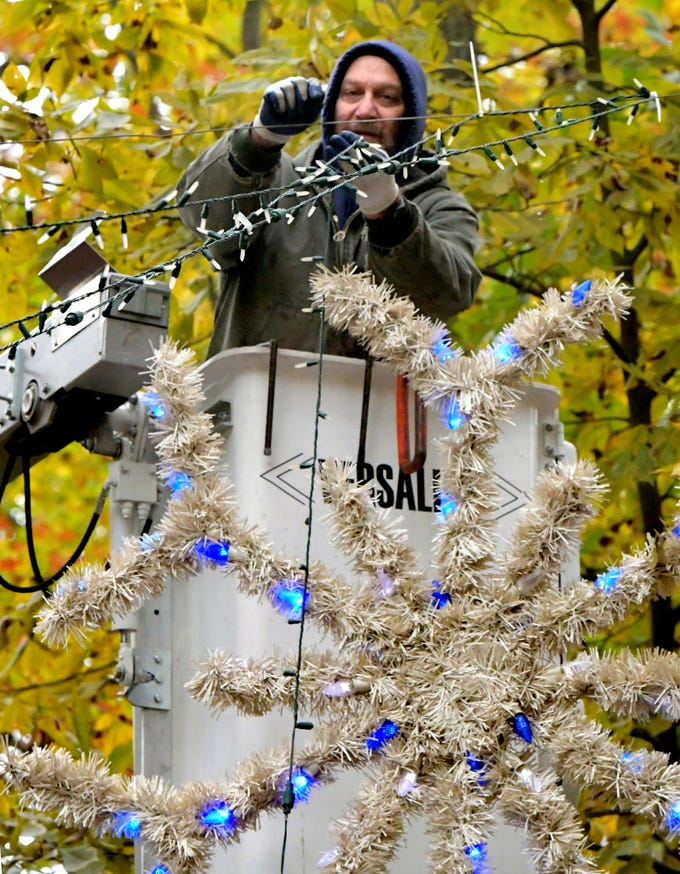 York County Parks and Recreation employee Randy Grove works from a bucket lift while stringing lights at Rocky Ridge Park, Monday, Oct. 29, 2018, while preparing for the Christmas Magic event. The event, featuring 600,000 lights along a half-mile trail, is in its 35th year. Christmas Magic runs daily from Nov. 23 through December 31. It is closed on Dec. 24 and 25. Hours for the event are Monday through Thursday, 6-9 p.m.; and Friday through Sunday, 5-9 p.m. Tickets will available online starting in early November, according to the department's website. Friday, Saturday and Sunday require pre-purchased ticket sales. Bill Kalina photo